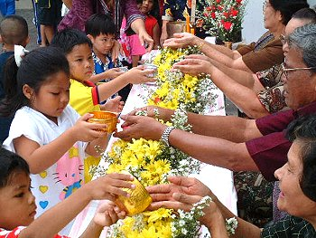 songkran-water-elders-hands